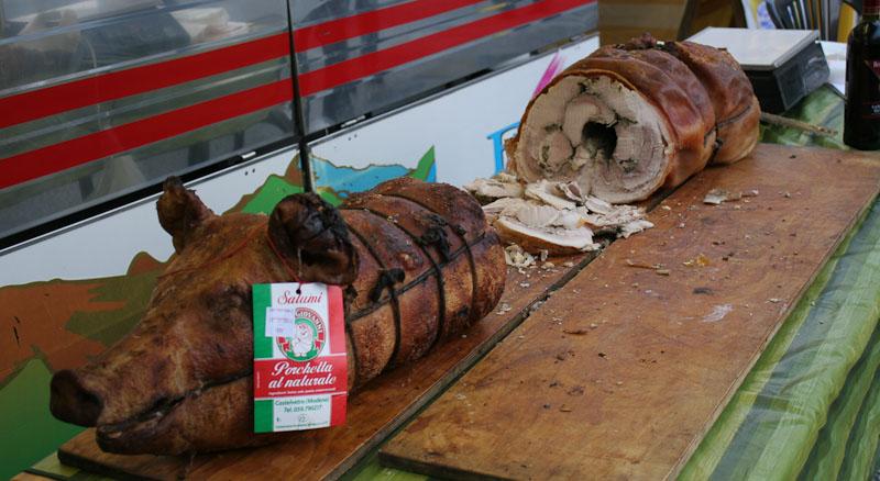 Porchetta served as street food at an Italian food fair.