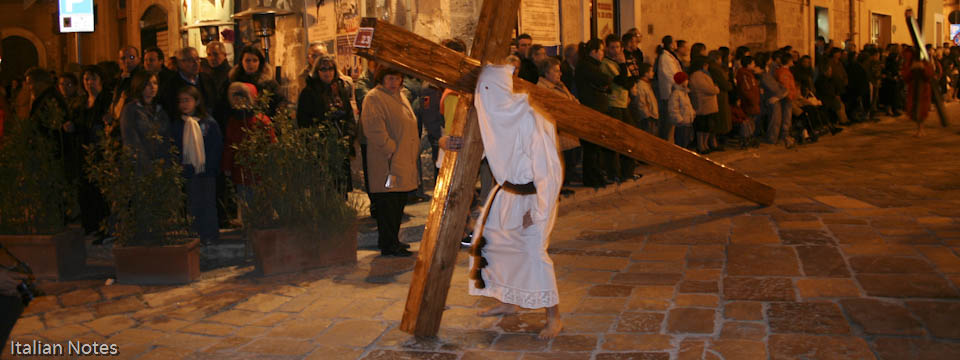 Image of penitents carrying the Cross during Easter in Francavilla Fontana