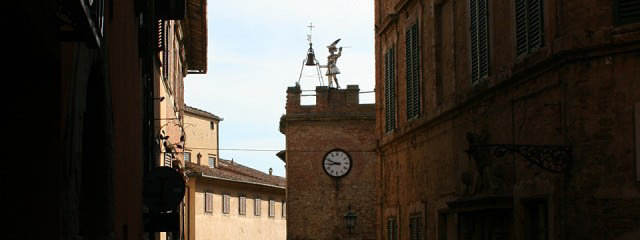 clock tower in montepulciano - Italian Notes
