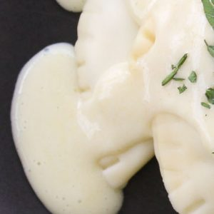 Radicchio stuffed pasta in cheese sauce