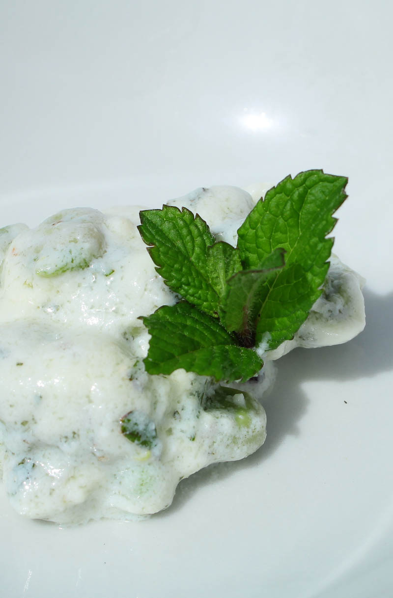 Fresh ricotta with fava beans and herbs