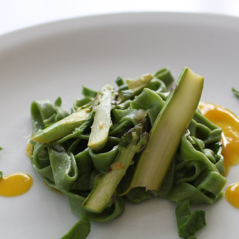 Green tagliatelle with saffron sauce