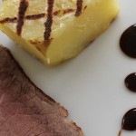 Roast beef with fondant potato and balsamic reduction sauce