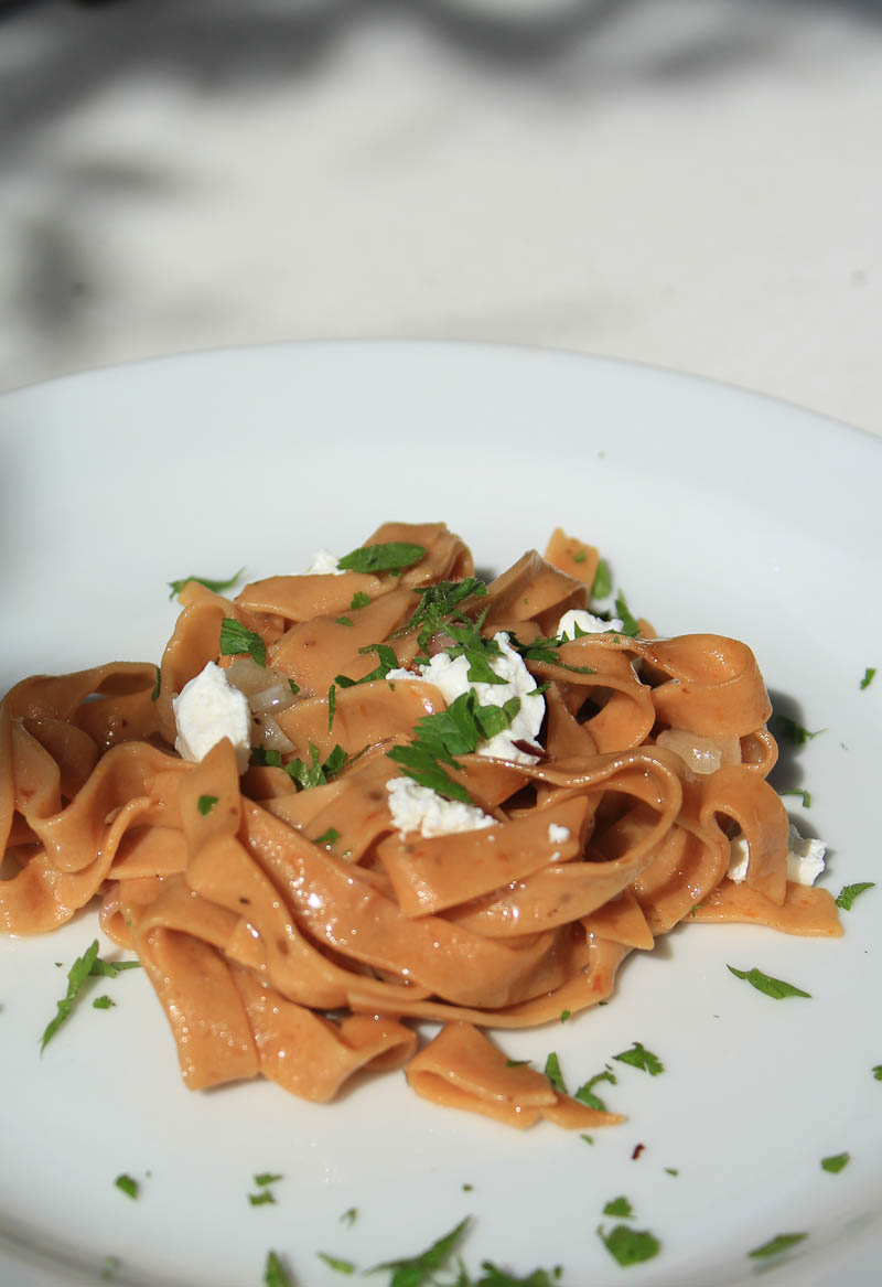 Tagliatelle rosso with speck and Tropea onion
