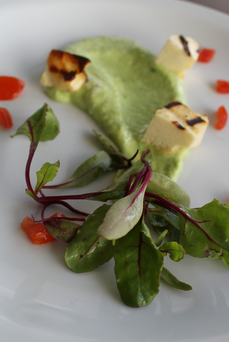 Pea purée with grilled cheese and beet sprouts