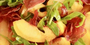 Peach, arugula, cured ham salad