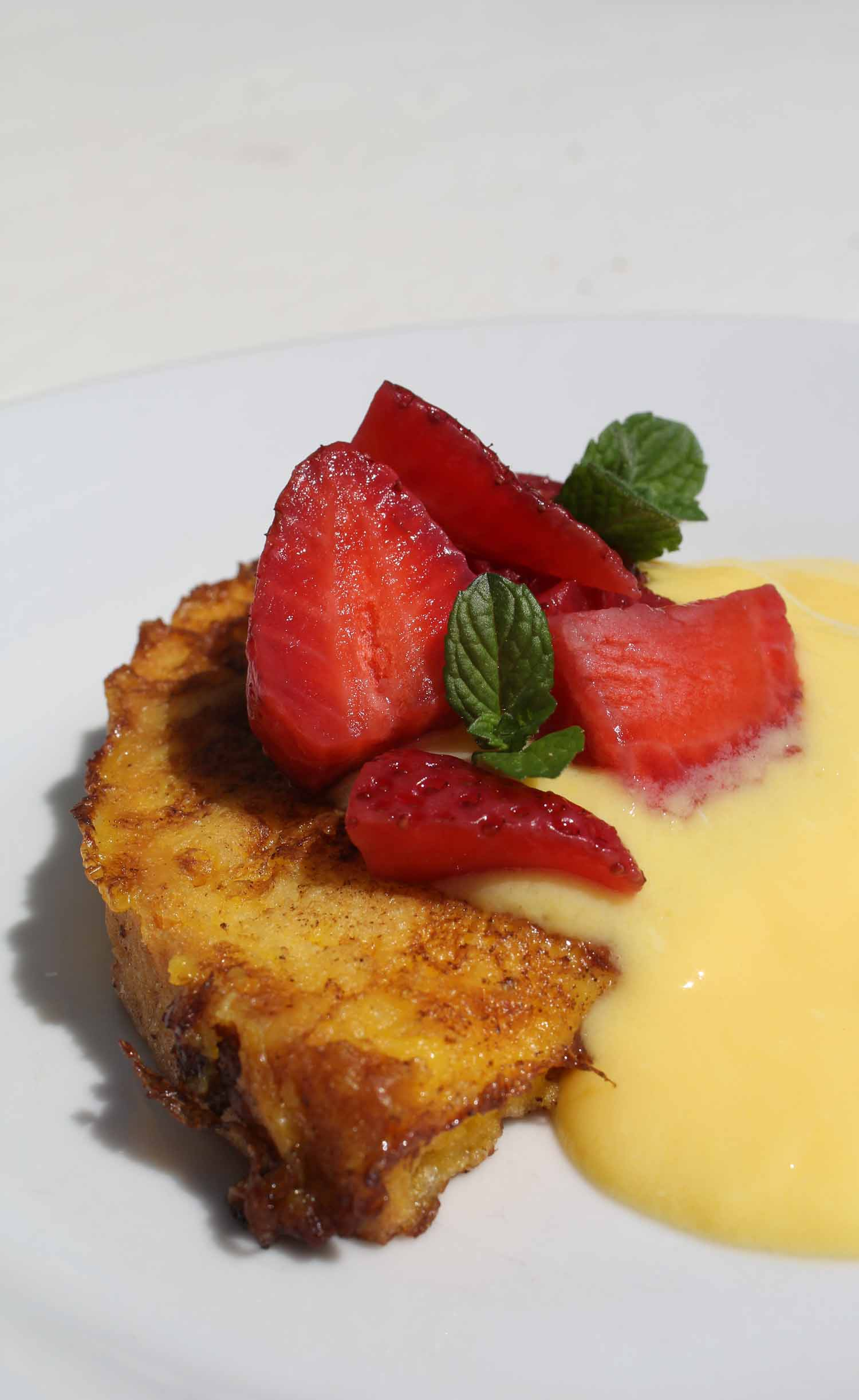 French toast with creme anglaise and strawberries